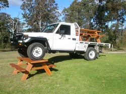 Solid Built Furniture Hand Made  in Australia. Natural Rustic Outdoor Table and Seating setting built so strong you can park a truck on it.