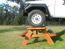 Solid Built Furniture Hand Made  in Australia. Natural Rustic Outdoor Table and Seating settings.